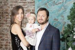 Family portrait near the Christmas tree. Stock Photos