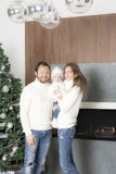 Family portrait near the Christmas tree. Stock Images