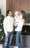 Family portrait near the Christmas tree. Stock Photography