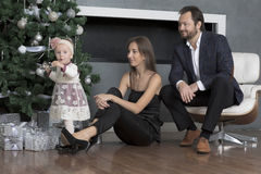 Family portrait near the Christmas tree. Royalty Free Stock Photo