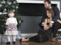 Family portrait near the Christmas tree. Royalty Free Stock Photos