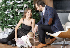 Family portrait near the Christmas tree. Stock Photos