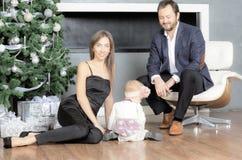 Family portrait near the Christmas tree. Stock Photo