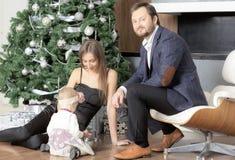 Family portrait near the Christmas tree. Royalty Free Stock Photos