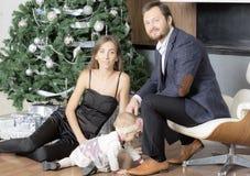 Family portrait near the Christmas tree. Royalty Free Stock Photo