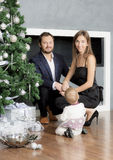 Family portrait near the Christmas tree. Royalty Free Stock Photography
