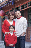 Family portrait outside by a traditional Chinese building royalty free stock photos