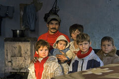 Family Portrait of poor Roma Gypsies, Romania. Romania: in the provincial capital city of Bacau, Group portrait of Roma Gypsies father, four sons, boys, and a Royalty Free Stock Image
