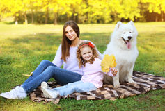 Family portrait, pretty young mother and child walks with dog Stock Photo