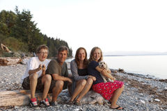 Family portrait on a rocky coastal beach royalty free stock images