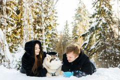 Family portrait with Siberian husky in winter. On snow Royalty Free Stock Image