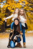 Family portrait of sisters in yellow autumn Park Stock Photography