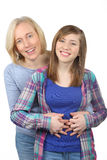 Family portrait of smiling mother and daughter Royalty Free Stock Photo