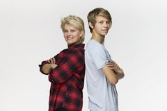 Family portrait. Smiling mother and son wearing casual clothing stock image