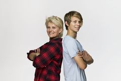 Happy and smiling mother and son. Loving family portrait against white background royalty free stock image
