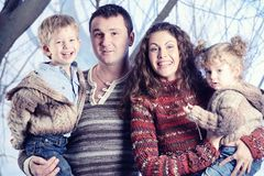 Family portrait standing on studio snow forest background Royalty Free Stock Photos