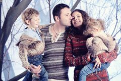 Family portrait standing on studio snow forest background Stock Photos