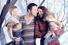 Family portrait standing on studio snow forest background Royalty Free Stock Image
