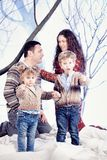 Family portrait in studio snow forest background Royalty Free Stock Images