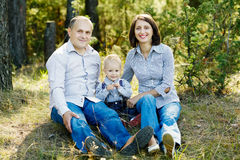 Family portrait in summer forest Royalty Free Stock Images