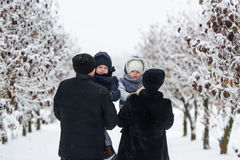 Family portrait in the winter park. Royalty Free Stock Image