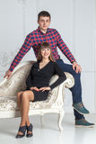 Family portrait of  young couple sitting on a couch Stock Image
