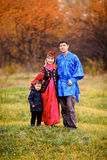 Family portrait of young family, father, mother and son outdoors in traditional national costumes. Royalty Free Stock Image