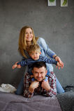 Family portrait. Young family of three people. Royalty Free Stock Image