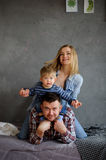 Family portrait. Young family of three people. Stock Photo