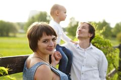 Family. Family Portrait. Young happy Family walking outdoor. Pregnant woman, husband and Child - happy Family having fun royalty free stock photography