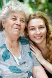 Family portrait of young woman and her grandmother Royalty Free Stock Images