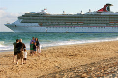 Family Poses For Photo As Cruise Ship Departs Stock Images