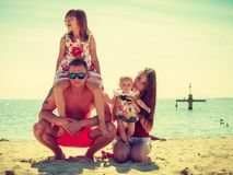 Family posing at beach near sea Royalty Free Stock Photography