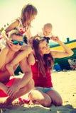 Family posing at beach near sea. Happy family spending time and having fun on beach Royalty Free Stock Photo
