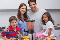 Family posing with a blender Stock Photography