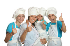 Family posing in chef uniforms Stock Photography
