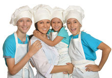 Family posing in chef uniforms Stock Image
