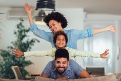 Family posing on the couch together at home in the living room, selective focus royalty free stock images