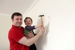Family posing with hammer Stock Photography