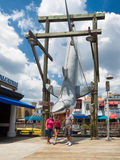 Family posing near shark from Jaws at Universal Studios Florida. ORLANDO,USA - AUGUST 23, 2014 : Family posing with a great white shark from the movie Jaws at stock photos