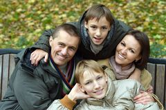 Family posing  in park Stock Image