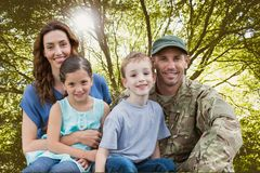 Family posing for photography against forest background royalty free stock photography
