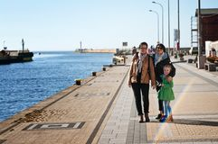 Family walking by Baltic Sea stock photography