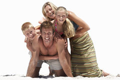 Family posing on sandy beach, smiling, portrait, cut out.  Stock Images