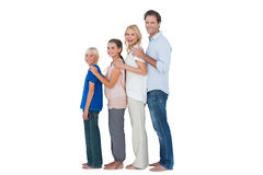 Family posing together and looking at camera Stock Images