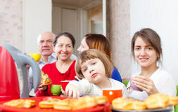 Family posing together over tea at home Stock Photography