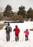 Family practicing cross-country skiing. The volcano Mount Etna, Sicily. Italy. Royalty Free Stock Images