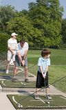 Family Practicing Golf Royalty Free Stock Photography