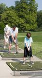 Family Practicing Golf Stock Image