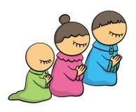 Family at pray Stock Photos